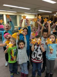 "And the kids show off their ""shining stars"" from Holy Moly and Epiphany"