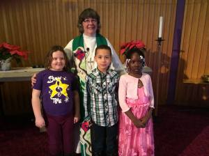 Pastor Kisten with 3 of our children, eager for the bread and the wine!